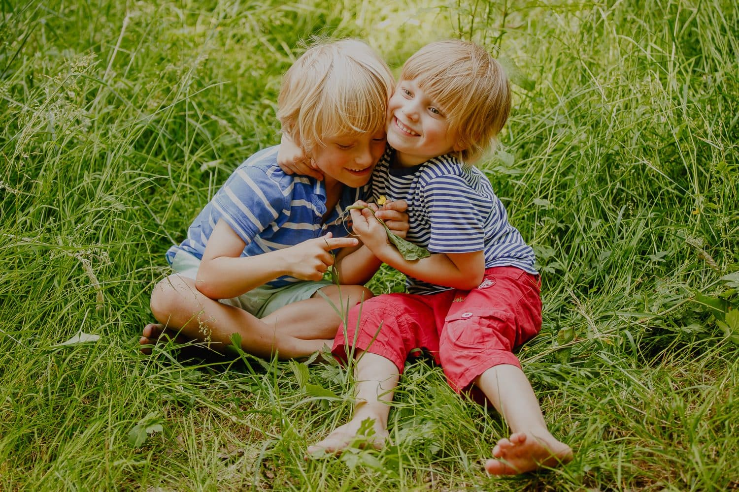 Young brothers hugging each other.