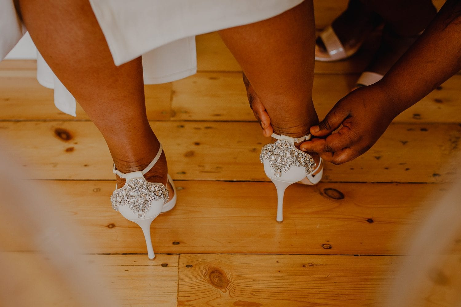 Bride wedding shoes with crystal on the back.