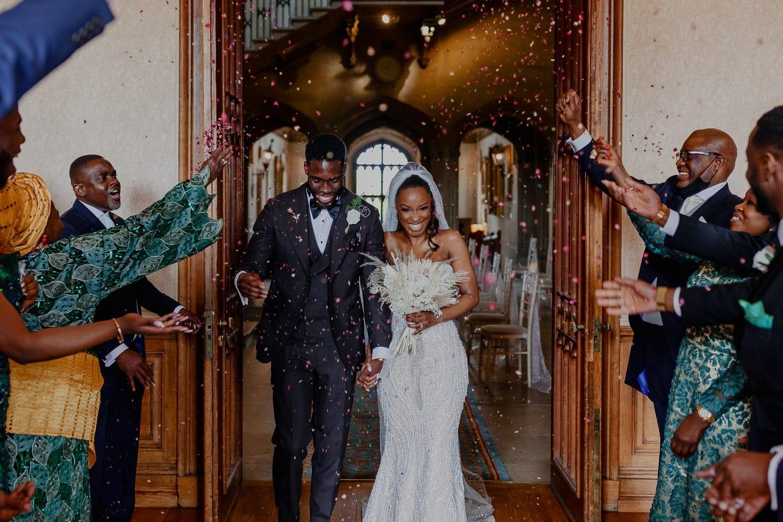 Confetti shower on bride and groom at Ashridge House